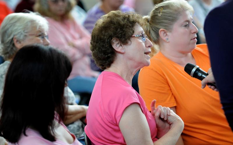 Participants ask questions at the physician panel on breast health.