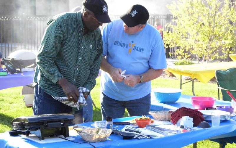 Chef Richard Taylor consults with his assistant David Wilson.